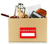 Box of unwanted stuff ready for a garage sale, isolated on white
