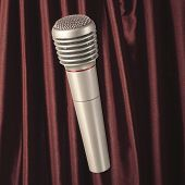 Silver microphone on brown curtain background