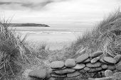 Stone Wall Shelter On A Beautiful Beach In Black And White