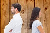 picture of not talking  - Upset couple not talking to each other after fight against wooden background - JPG