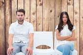 Angry couple not talking after argument against wooden planks