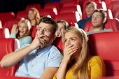 Постер, плакат: cinema entertainment and people concept happy friends watching horror drama or thriller movie in