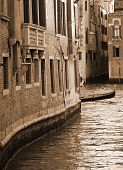Italy. Venice. Canal Among Old Brick Houses. In Sepia Toned. Retro Style