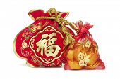 Two Chinese New Year Gift Bags and Gold Ingots on White Background