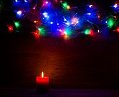 wooden background for labels with Christmas lights