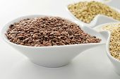 closeup of a bowl with brown flax seeds
