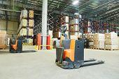 Manual forklift pallet stacker truck equipment at warehouse