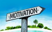 Motivation sign with a beach on background