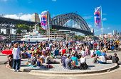 SYDNEY,AUSTRALIA-DEC 31, 2014: People near Harbour bridge on Dec 31, 2104 in Sydney,Australia.News years eve celebrations at Harbour Bridge,attended by almost 1 Million people from all over the world.