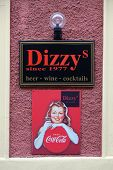 GRAZ, AUSTRIA - JANUARY 10, 2015: Dizzy bar and advertisement for Coca Cola in Graz, Styria, Austria on January 10, 2015.