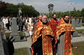 PRAGUE, CZECH REPUBLIC - MAY 9, 2013: Eastern Orthodox priests attend the celebration of Victory Day at the Soviet War Memorial at the Olsany Cemetery in Prague, Czech Republic.