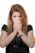 stock photo of hay fever  - Beautiful woman with a cold hay fever or allergies blowing her nose - JPG