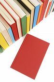 Plain Red Book With Row Of Colorful Books