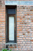 Retro Window With Red Brick Wall