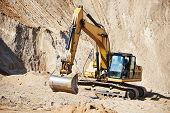 stock photo of excavator  - excavator machine at excavation earthmoving work in sand quarry - JPG