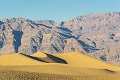 picture of mesquite  - The Mesquite Flat Dunes in Death Valley National Park with arid mountains in the background - JPG