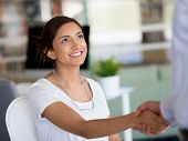 Young woman shaking hands with someone