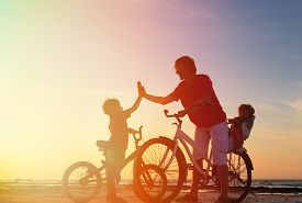stock photo of little sister  - Biker family silhouette - JPG