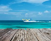 foto of hydroplanes  - Twin otter seaplane at Maldives and old wooden pier - JPG