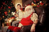 foto of christmas claus  - Santa Claus in his everyday clothes in Christmas home d - JPG