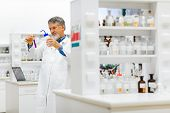 picture of chromatography  - Senior male researcher carrying out scientific research in a lab  - JPG