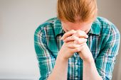 image of prayer  - A casual young woman says a prayer with her hands held together - JPG
