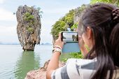 Постер, плакат: Female Traveler Shooting Natural View By Mobile Phone