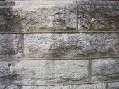 stock photo of foundation  - Limestone block and mortar make up the foundation of a local church - JPG