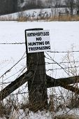 picture of infraction law  - private property sign and no hunting sign - JPG