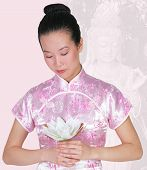 Asian Women With Quanyin Statue