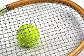 Tennis Ball With Tennis Racket Strings And Frame