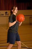 Teen Girl Playing Basketball