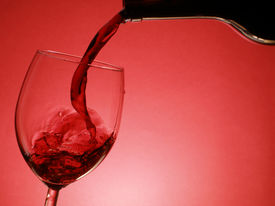 foto of red wine  - red wine pouring into the glass over red background - JPG