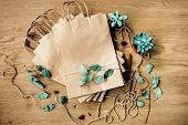 Brown Craft Paper Bags Packaging Template With Stitch Sewing On Wooden Background. Packaging Templat poster
