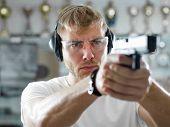 Man holding gun poster