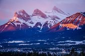 Three Sisters Mountain View At Sunrise Time In Canmore Town In Canada, Canadian Rockies Landscape At poster