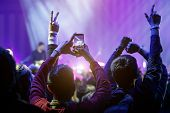 Hand With A Smartphone On Live Music Concert, Taking Photo Of Stage, Live, Music Festival. poster