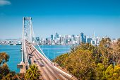 Classic Panoramic View Of San Francisco Skyline With Famous Oakland Bay Bridge Illuminated On A Beau poster