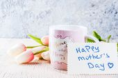 Mothers Day Concept, Greeting Card Background. Flowers Tulips On A Light Concrete Table, Mug With I poster