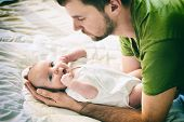 Father And Child On A White Bed. Father And Baby Boy In Diaper Playing In Sunny Bedroom. Father Make poster