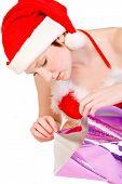Hada de la Navidad desenvolver un regalo