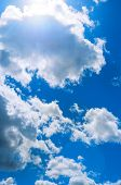Sky Landscape Of Blue Cloudy Sky With Sunlight Beams. Blue Sky Background With White Dramatic Clouds poster