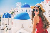 Travel Europe summer holiday girl enjoying Oia, Santorini Greece cruise vacation. Sun getaway Asian  poster