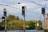 Three signals and overhead wires