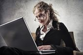 Beautiful businesswoman using a laptop