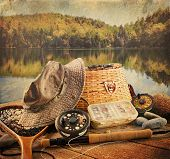 stock photo of fly rod  - Fly fishing equipment on deck with a vintage look - JPG