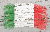Flag Of Italy On Grunge Wooden Texture Painted With Chalk