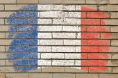 Flag Of France On Grunge Brick Wall Painted With Chalk