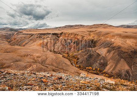 poster of Panorama Gorge In Mountains. Beautiful Landscape Red Mountains In Cloudy Weather. Gorge Martian Land