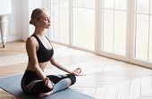 Yoga Girl With Closed Eyes Sitting In Lotus Pose And Meditating In Yoga Studio, No Stress Concept, C poster